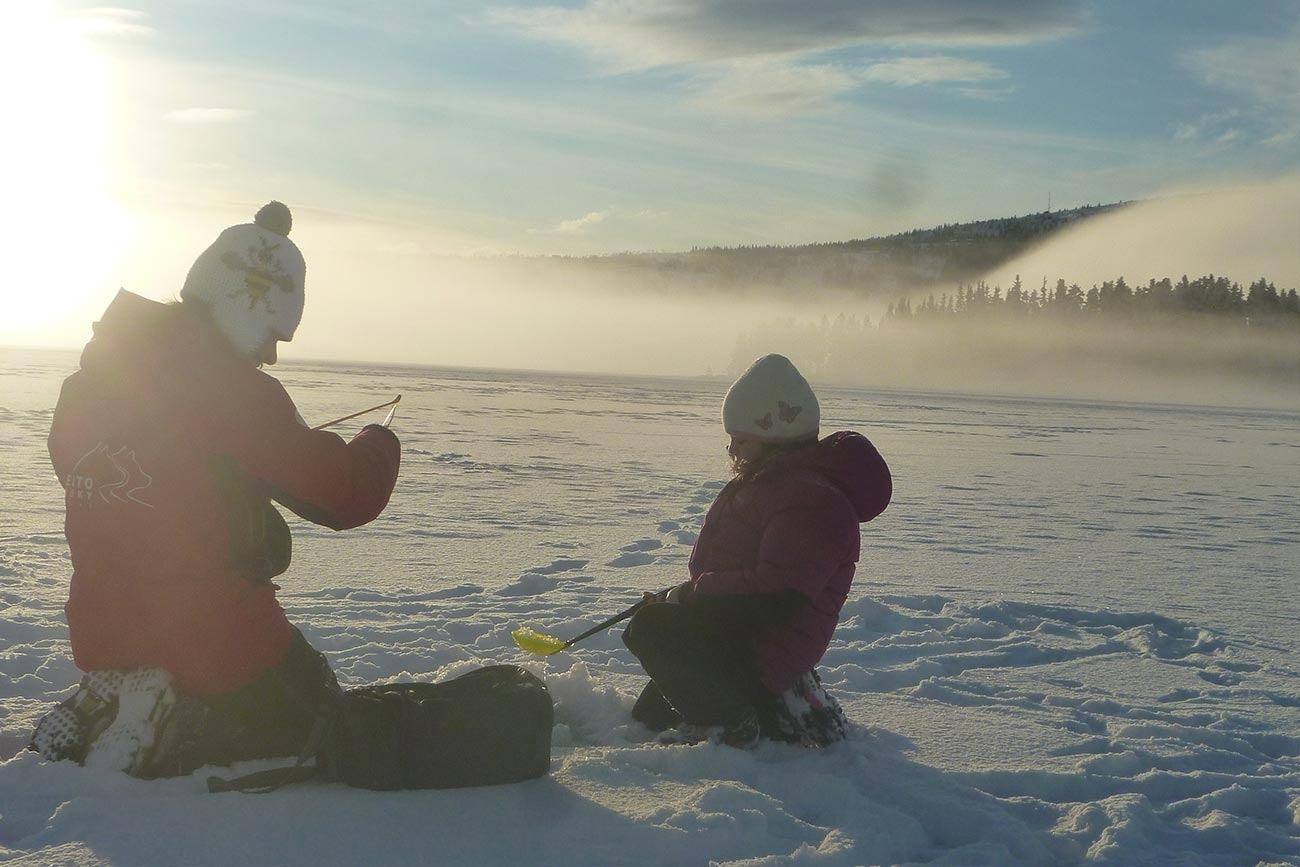 Ice fishing, popular family winter activity in Norway | Beito Husky Tours